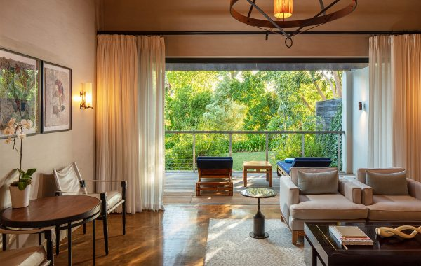 Deluxe lodge living room leading onto terrace overlooking gardens. at Delaire Graff Estate
