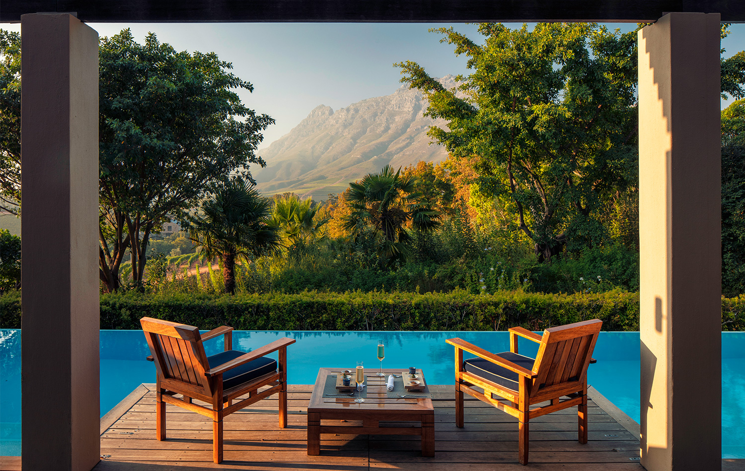 Presidential Lodge 2 terrace and 12 metre swimming pool overlooking Stellenbosch mountains at Delaire Graff Estate South Africa