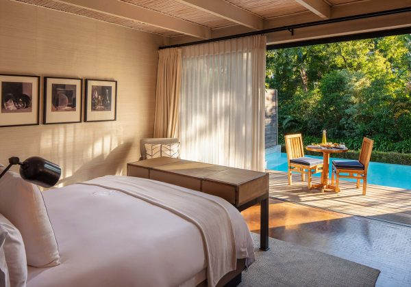 A deluxe lodge king size bedroom and private terrace with heated plunge pool