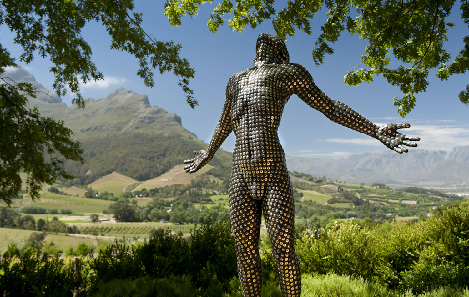 An Anton Smit statue of a human form in the gardens of Delaire Graff Estate