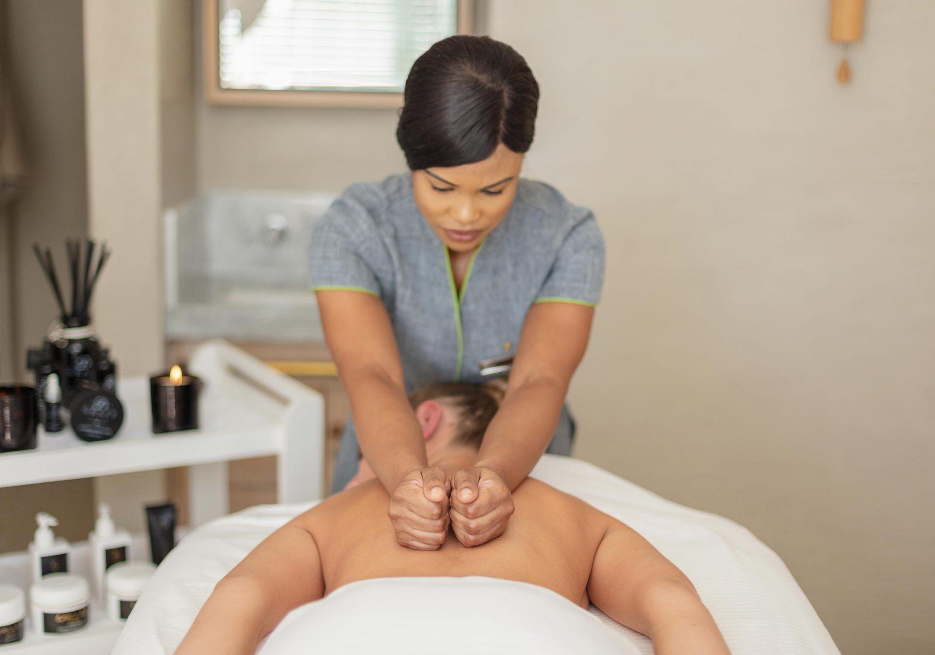 A lady enjoying a back massage