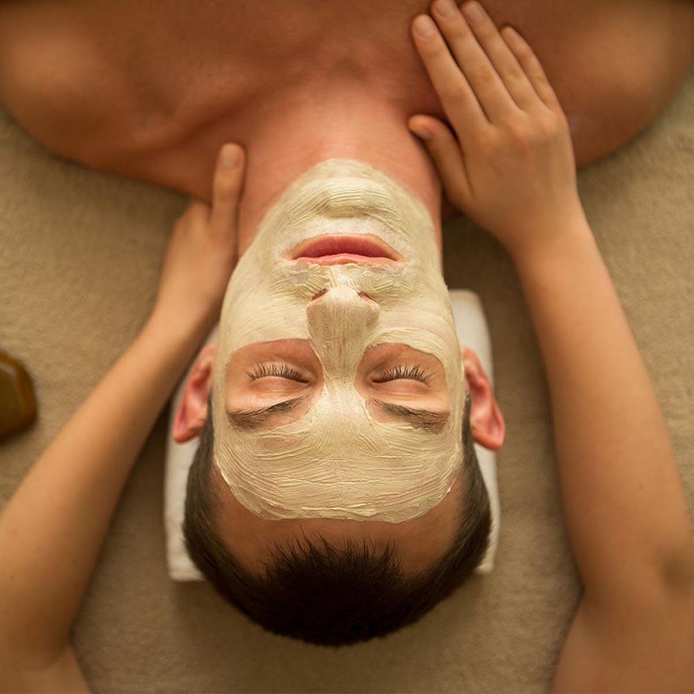 a gentleman having a face mask treatment