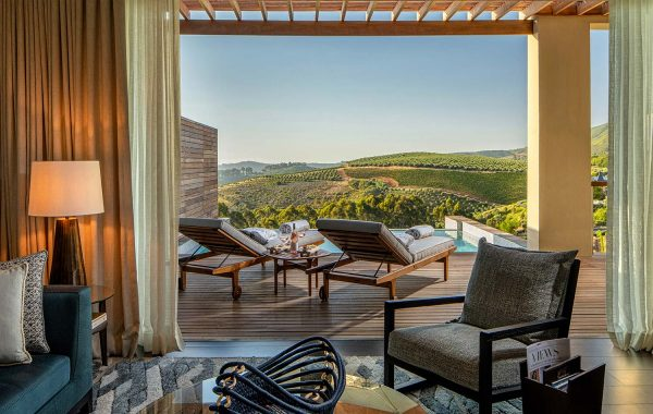 View from a Superior Lodge living room towards the terrace and plunge pool with views towards False Bay and Stellenbosch vineyards