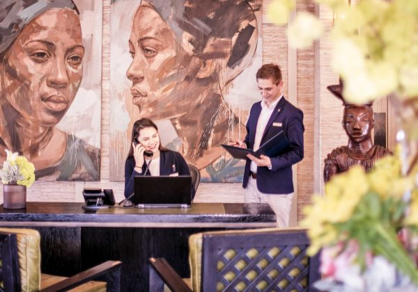 The Delaire Lodges & Spa reception team behind front desk