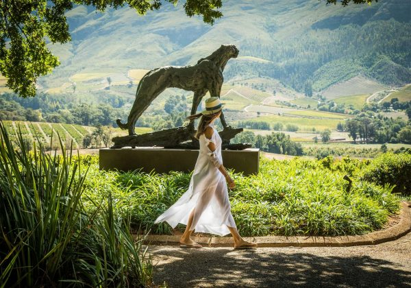 a lady walking in the grounds of Delaire Graff Estate